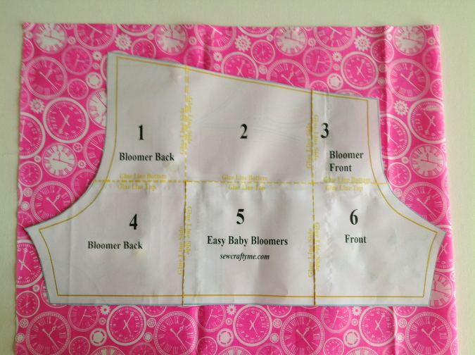 Fold the fabric to fit the width of the template and place the template over it. Mark around it and cut to get the bloomer pieces.
